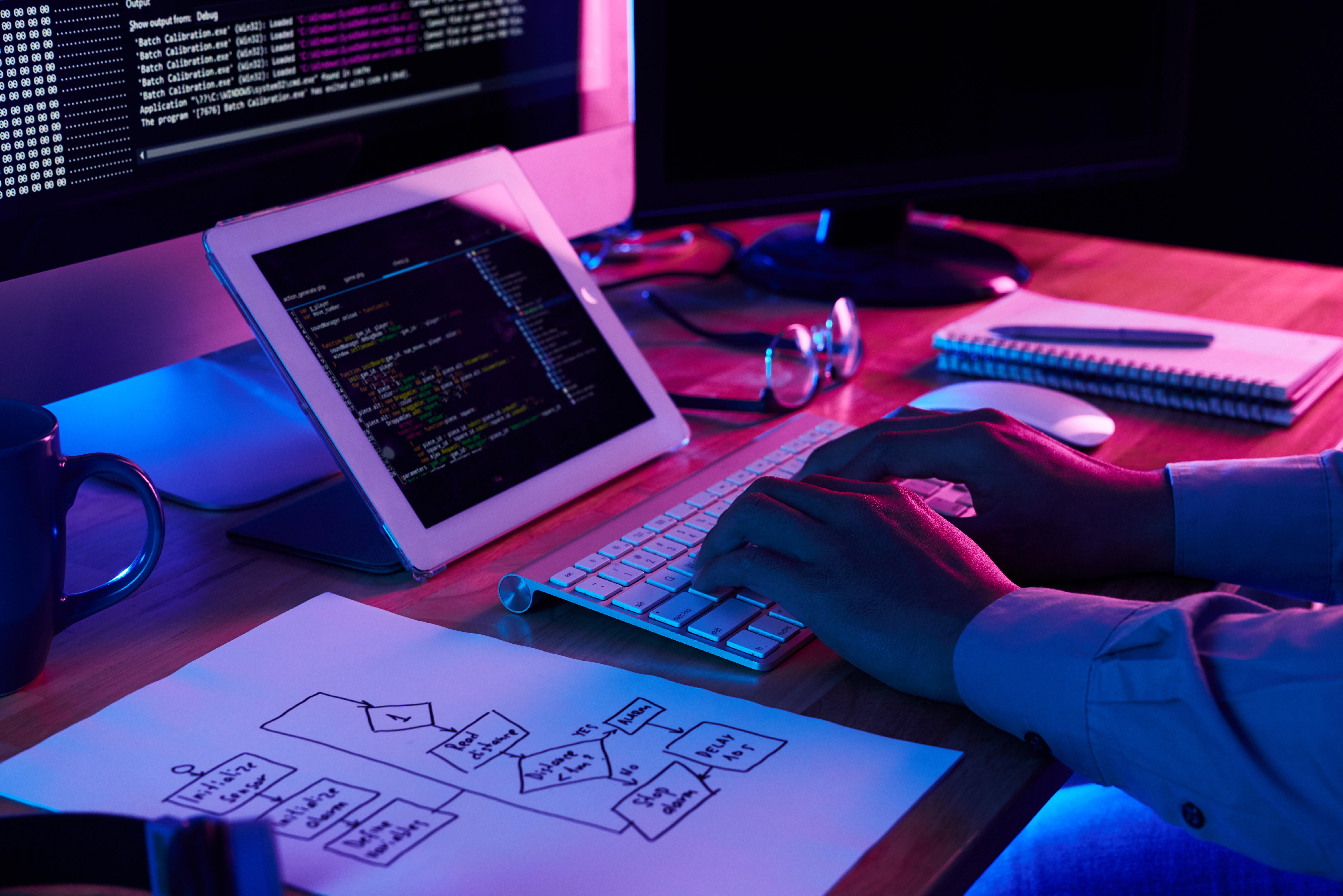 close-up-image-programer-working-his-desk-office.jpg